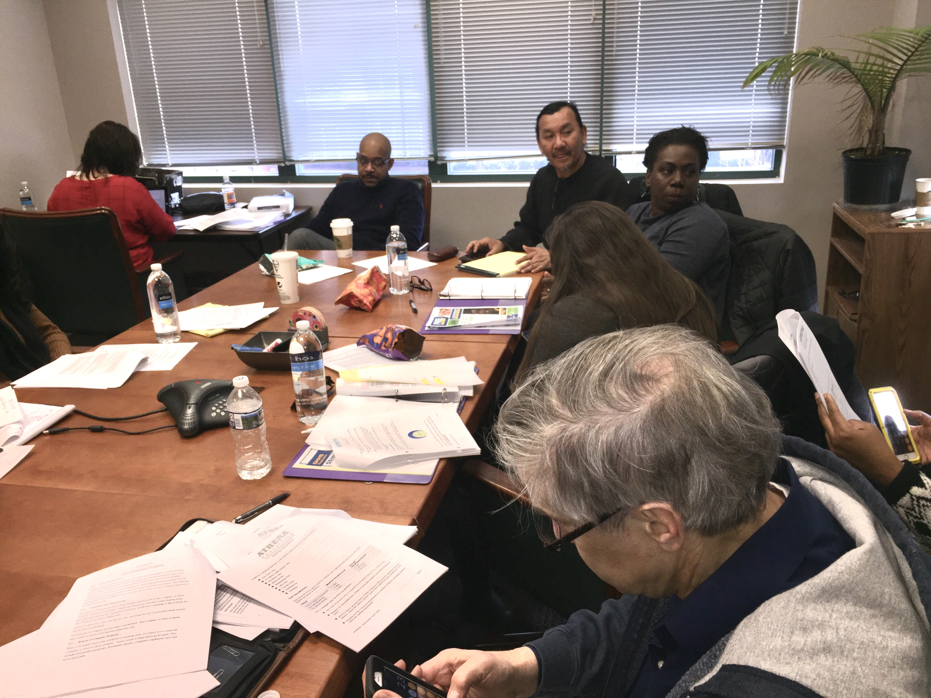 pictures of Athena members at the bargaining table